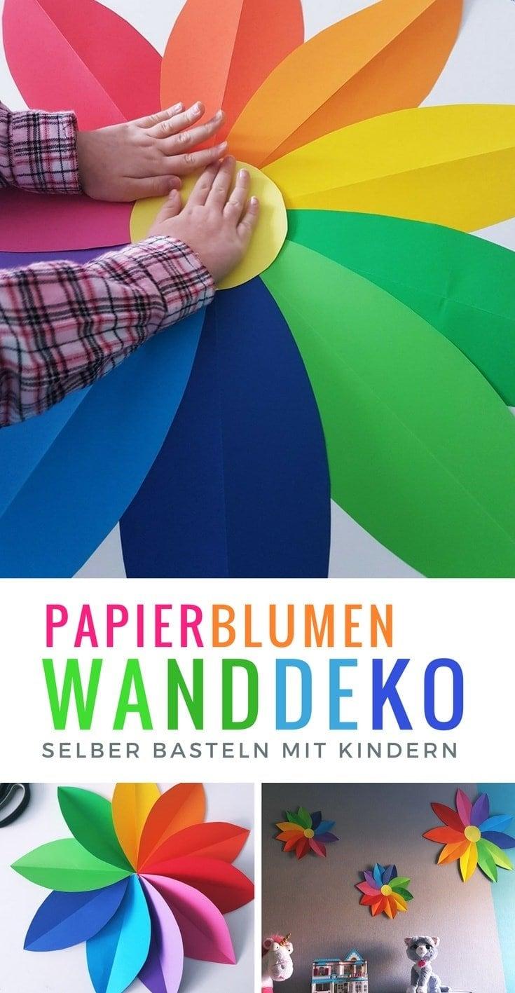 Regenbogen Papierblumen basteln mit Kindern als Kinderzimmer wanddeko. #Regenbogen #basteln #kinderzimmer #deko